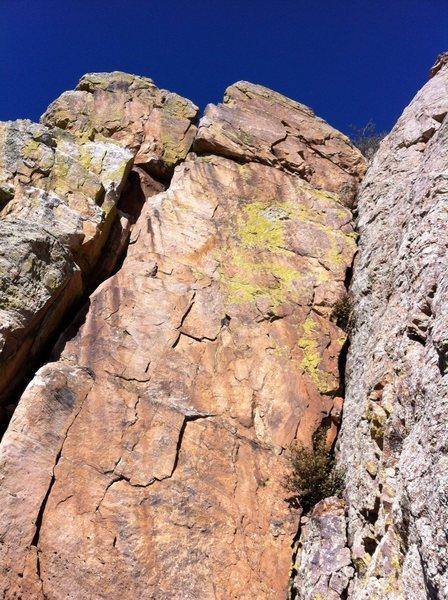 Climb the face - avoid the cracks.