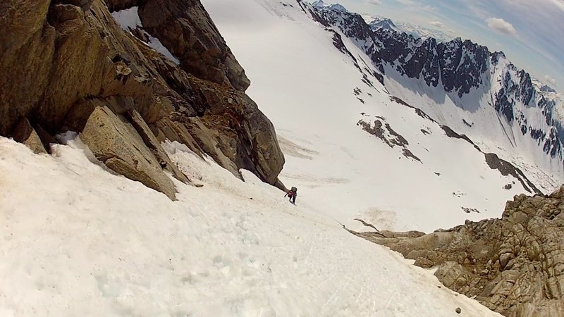 Climbing a coulior of steep snow on the First Ascent of: The Ship's Prow, near Skagway, Ak