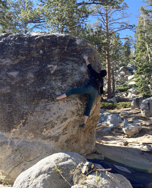Making the crux bump at full extension.