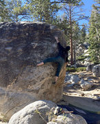Rock Climbing Photo: Making the crux bump at full extension.