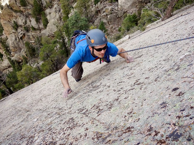 Bearing down on one of the few tiny crimps on the slab