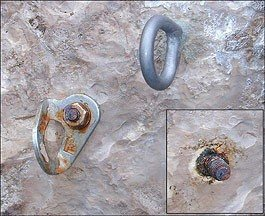 An unsafe corroding stainless steel bolt and the titanium bolt that replaced it.  Cayman Brac circa 2001.  Photo by Skip Harper.