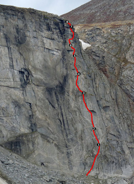 The right side of the wall with the route and belays marked.