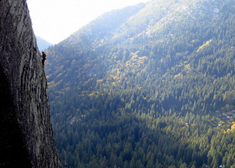 A climber on P3 of Traveler Buttress. Afternoon in October. View from Central Wall. <br> <br> Photo: Corey Gargano