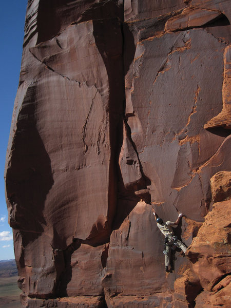 Rock Climbing Photo: Starting on the tricky face moves to gain the fing...