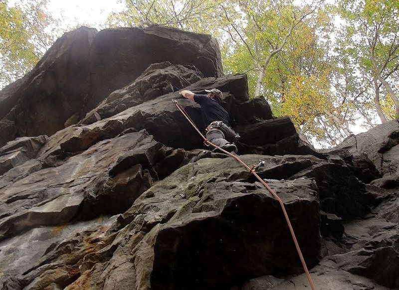 """Having fun climbing the route called """"Petrified"""". You can see the petrified log for which the route got its name to my right."""