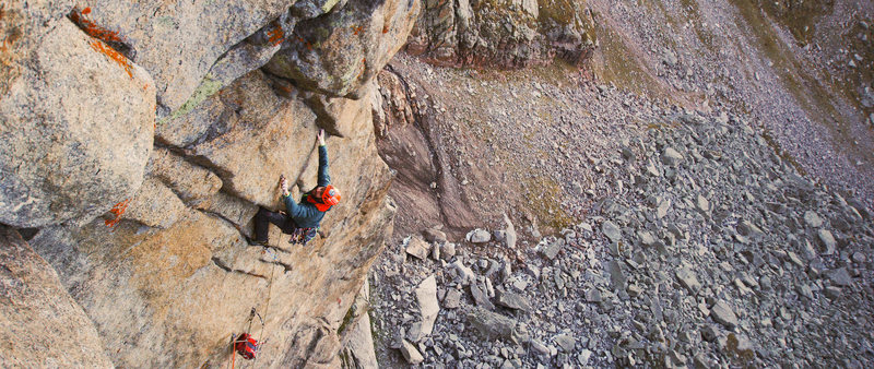 Rock Climbing Photo: Clipping the bolt in the middle of the crux on pit...