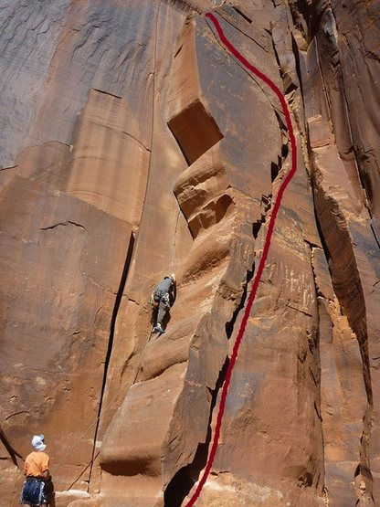 A climbing on Wavy Gravy on the left. Anal Leakage is the route to the right.
