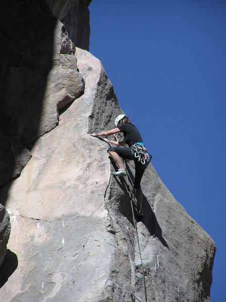 Margy Marshall starts to pull the balance crux at bolt 12.
