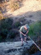 Rock Climbing Photo: Cori rappels while Matt and Amanda watch from Foot...