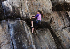 Rock Climbing Photo: Jasmyn pulls on the roof at Smoke Rock