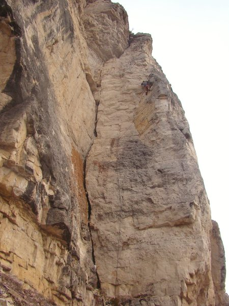 Lee Terveen in first accent heaven.<br> Straight With An Eight, 5.12a<br> Indencent Exposure, Blue Sky.<br> Spearfish Canyon, SD.