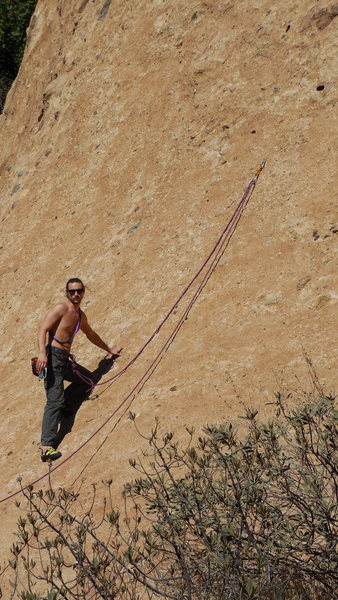 "An experienced climber using the 1st bolt and the lower slab of ""Hyperion"" to demonstrate footwork and give their new partner practice belaying."