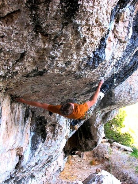 Pulling out the roof boulder problem.