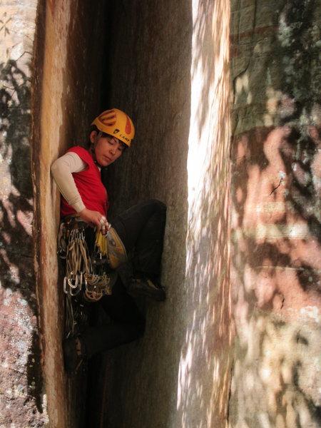 Chinese climber chimneys up slowly.
