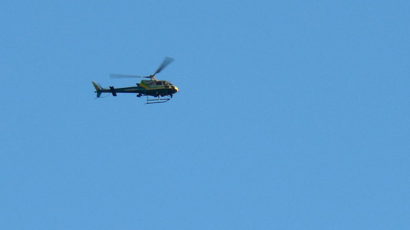 A helicopter making a flyby over the Egg, at Texas Canyon. Helicopter traffic has gotten to be quite frequent.