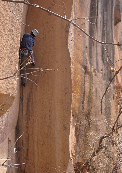 Aaron Miller in the crux <br> dihedral section of <br> Holy Grail (5.11+)