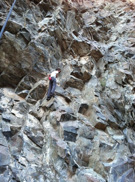 "Amber nearing the 1st-pitch crux of ""Astro Devil""."