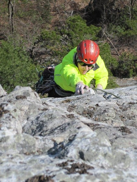 Gail pulling one of the crux moves on P2 of Westward Ha. Photo by Seth