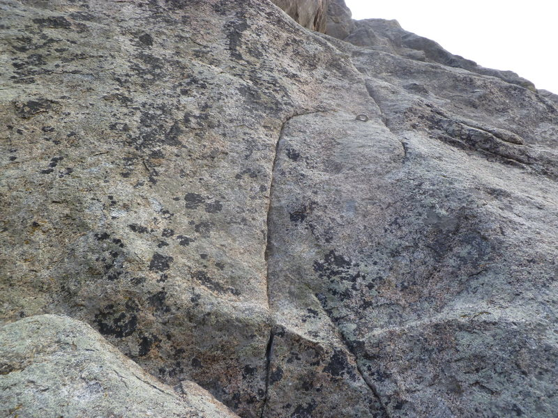 The upper bolt and the crux area.