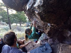 The legend, Lynn Hill herself, flashing the Leaning Boulder!