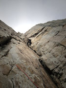 Rock Climbing Photo: Micah cruising the dihedral on pitch 4.