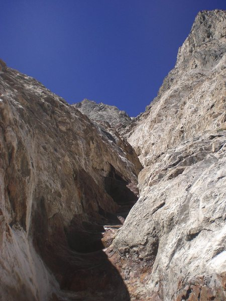 From the bottom head up this first chute (deep and red on the bottom). It looks steep, but there's an easy exit on the top. And the surrounding rock is bad climbing.