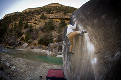 Wyatt Edwards sending Angler V2 on the riverside boulders <br />-taken by Wyatt Johnson <br />instagram @the_visionist <br />