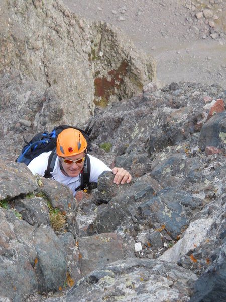 George Wilkey topping out on the 4th class pitch just below thw summit of Crestone Needle.