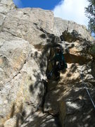 Rock Climbing Photo: Deb pulls through the bulgier but easier lower sec...