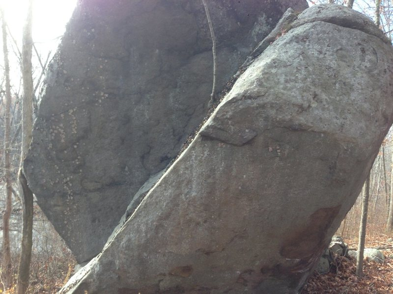 Plumb Line, V6.  Awesome line on an awesome boulder.