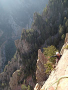 Rock Climbing Photo: Unknown climber hanging out near the top of Rebuff...