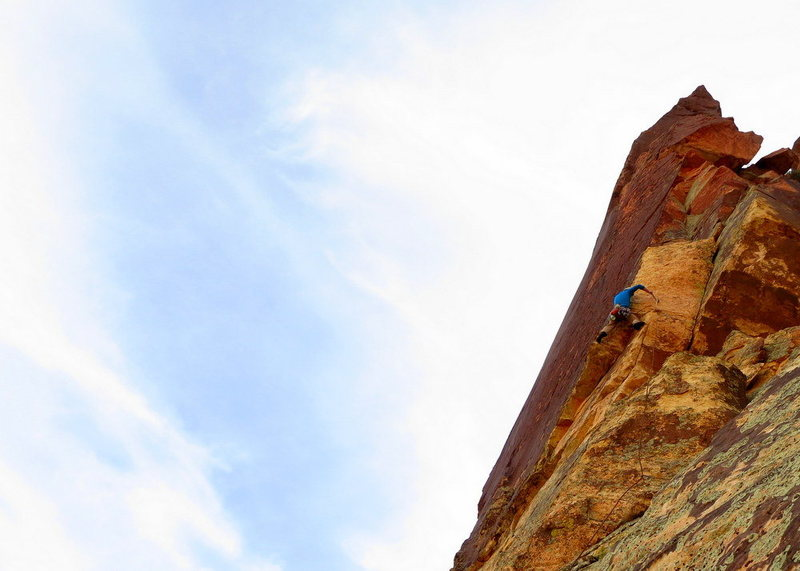 P6. Turning the arete and moving into the upper portion of the route. The tooth looms above. <br> <br> Photo: Corey Gargano