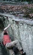 Rock Climbing Photo: John bares down.