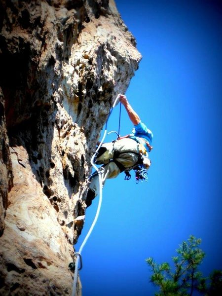 Rock Climbing Photo: Clipping the 4th bolt.