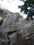 Picture of A Love Supreme from the Cloud 9 Ledge.  Follows seam to small ledge then up dihedral.
