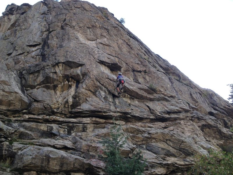 Erin Miller pulling the 1st roof (crux) of Child's Play.