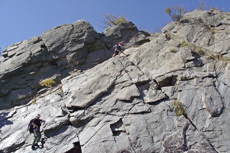 Scrambling up to the top of the Knob to set the top ropes.  Photo: Dave Rockwell