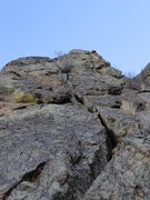 The route follows the obvious crack before traversing right and topping out via the upper crack.