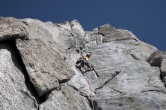 Rock Climbing Photo: Leading up the long p2 corner of the South Buttres...