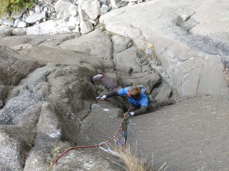 Starting the 5.11 finger section past the crux on pitch one.