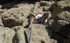 Rock Climbing Photo: Micah pulls through the last bulge in the roof on ...