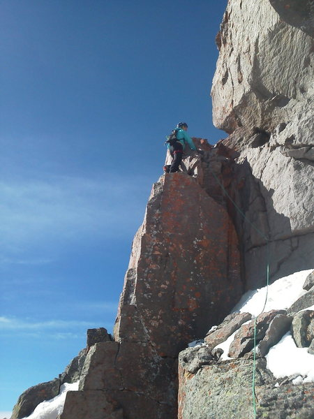 Jon Fike getting into the business, on the East side, ~50 feet below the summit.