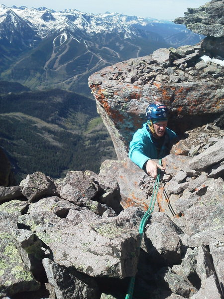 Fike topping out the final 30' chimney off the ledge on the east side of the South face of the summit block.