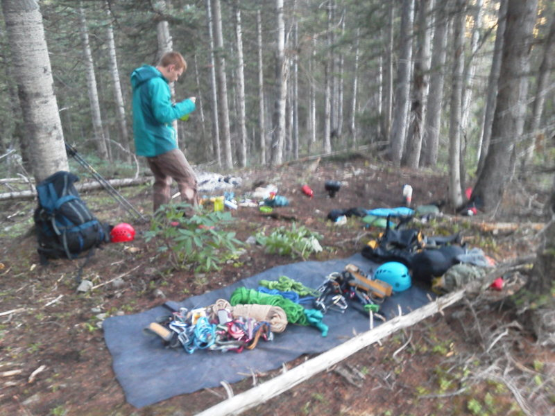 Rock Climbing Photo: Jon Fike and our bivy in the woods below the North...
