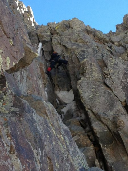 The crux, the first bit of rock above the snow.  Following the chimney along the right edge of the headwall.