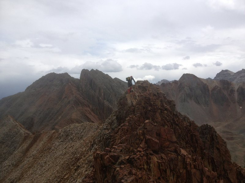 Descending the East ridge of Mears through very loose red shale.
