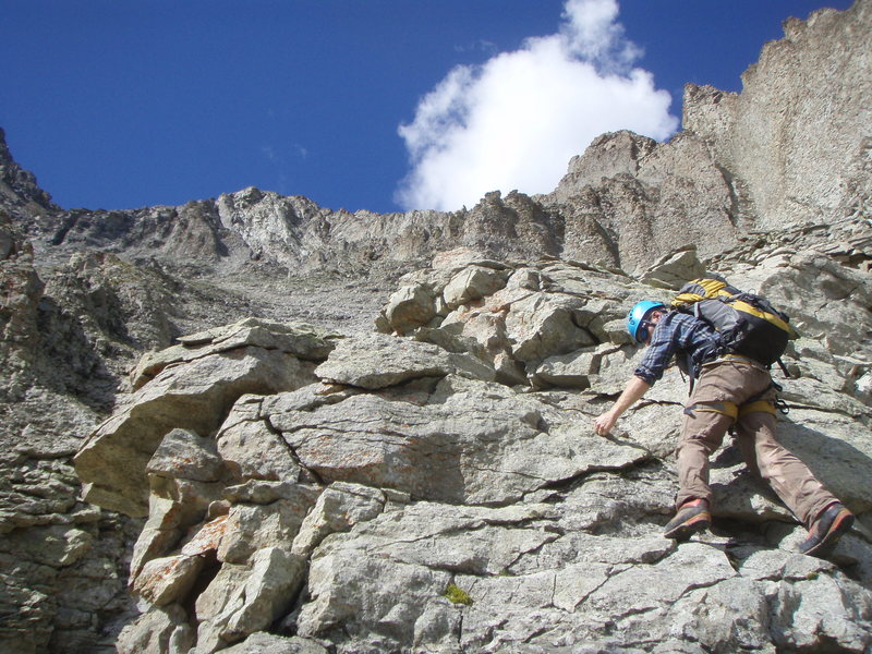 Some of the irreversible, unprotectable, steep, loose climbing to gain the North ridge, which is the skyline above.