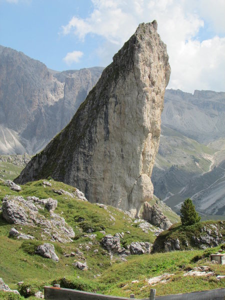 "The rock spire ""Piera Longia"" near base of the Grosse Fermeda, complete with a 200' vertical and overhanging, UIAA Gr.VI face climb."