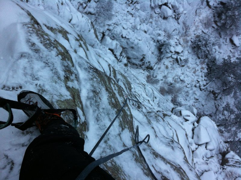 Looking down from the top of the second pitch on a snowy aid solo. No crowds today....